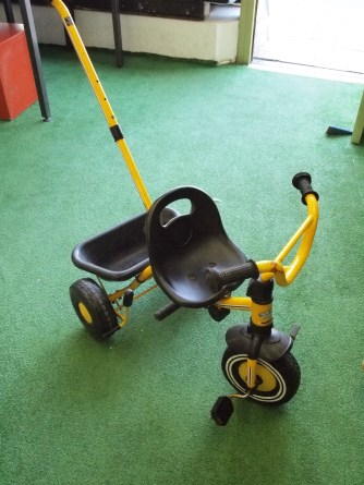 Child's tricycle with handle extension attachment